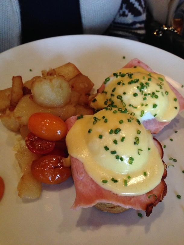 Fabbrica Benny - poached eggs atop prosciutto and fontina crumpets covered with hollandaise.