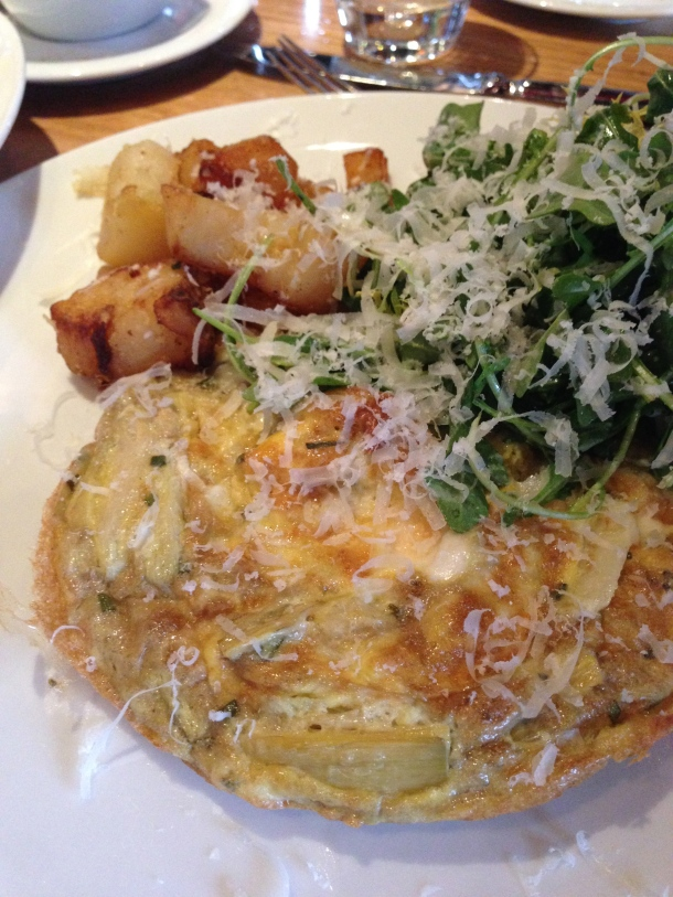 Frittata - made with taleggio, rosemary, artichoke served with arugula salad and homefries.