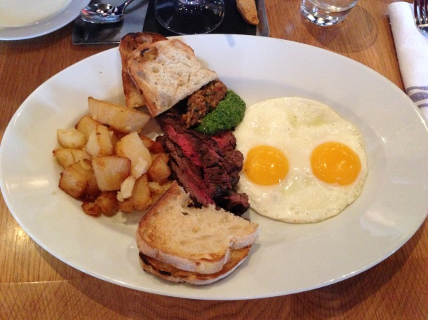Steak and eggs - skirt steak with two fried eggs, salsa verde, bomba, homefries and toasted ciabatta.